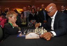 Zuma and boy (5) trade chess moves