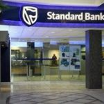 Standard buys into Russian bank