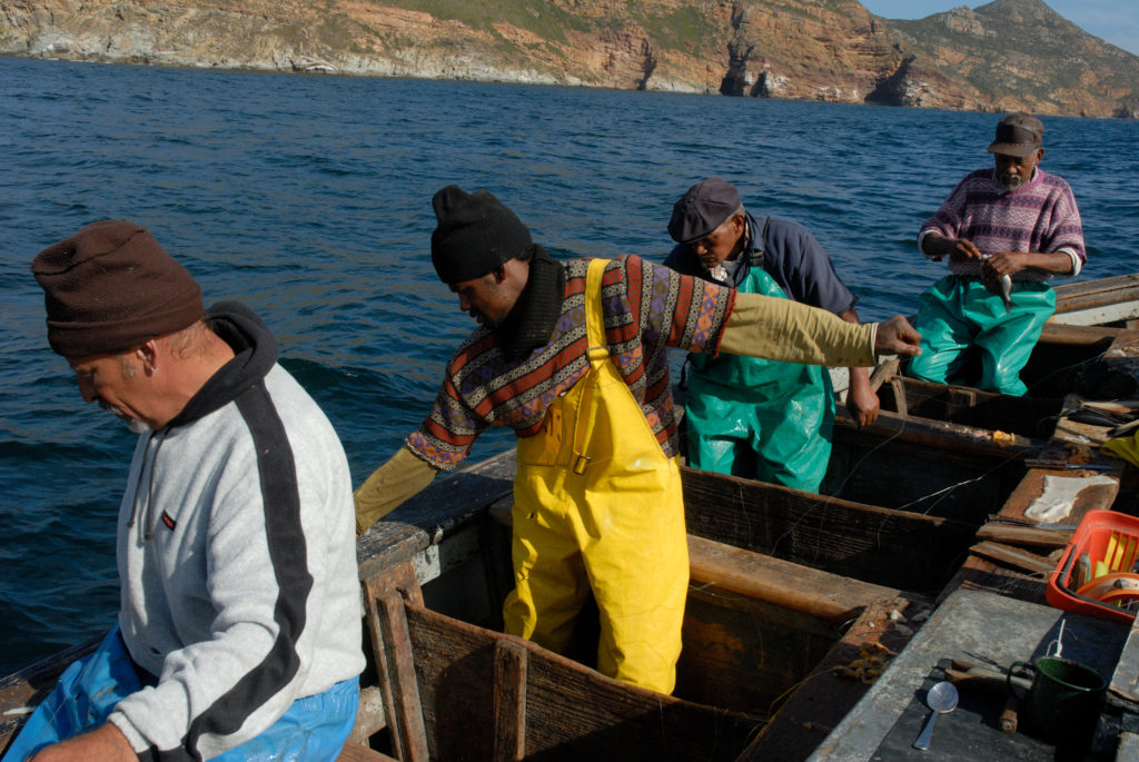 Cape Town, Western Cape province: Fishermen fishing with hand lines off Cape Point