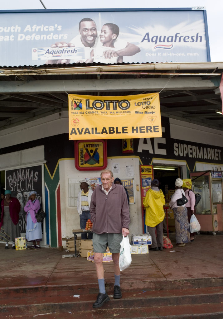 A man exits a local supermarket in the town