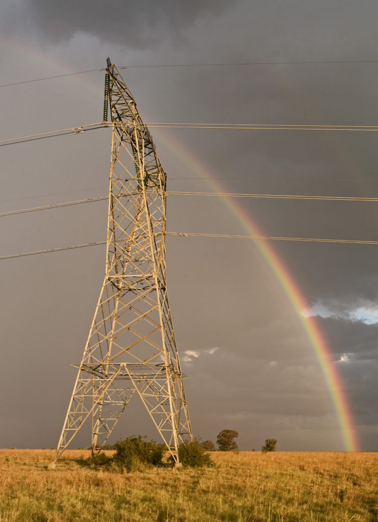 Free State province: Rainbow over Eskom electricity pylons