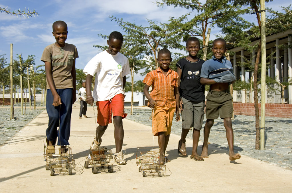Boys play with home-made toy cars made of wire in the Soweto suburb of Kliptown