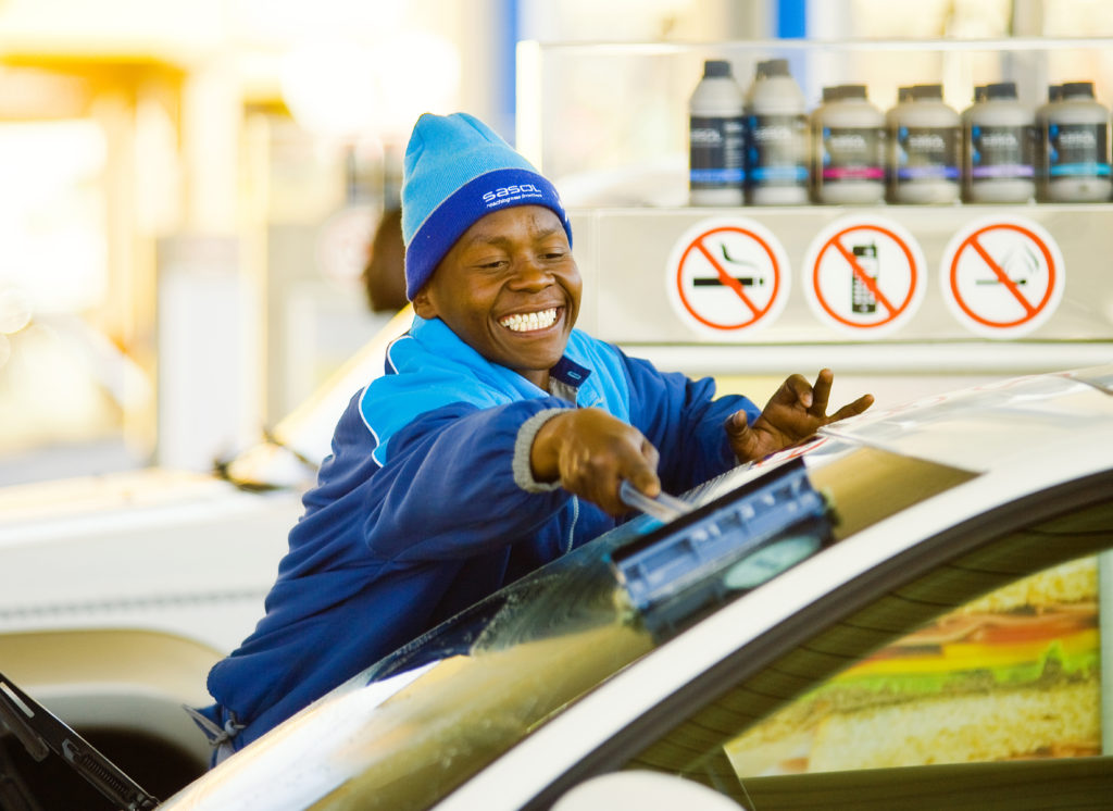 Attendant working at a petrol station owned by Sasol