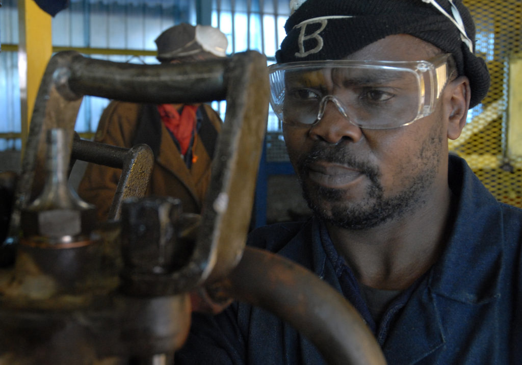 Fitter aide Zolile Manianiana fixes broken drills at Harmony Gold Mine