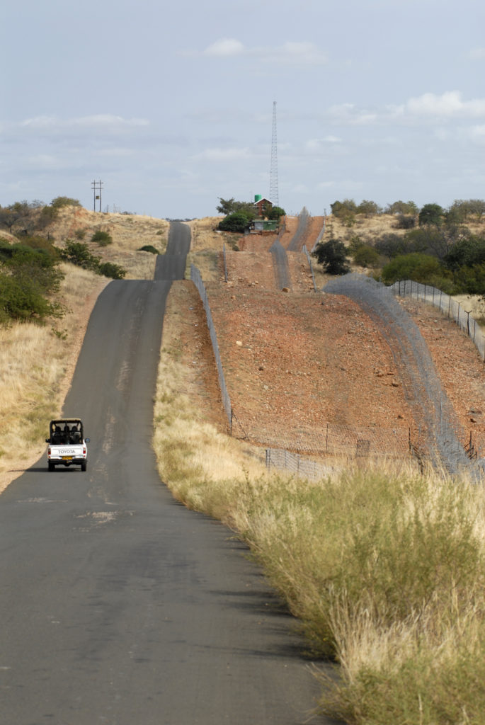 South Africa, Limpopo: Fence on the border between Zimbabwe and South Africa