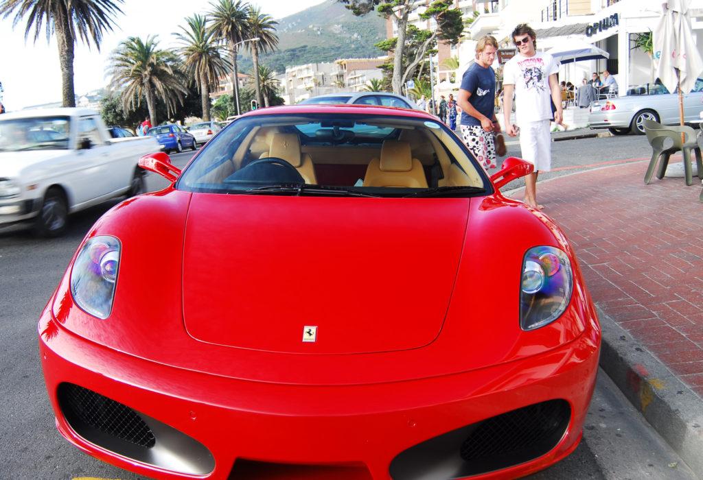 Admiring a Ferrari in Camps Bay