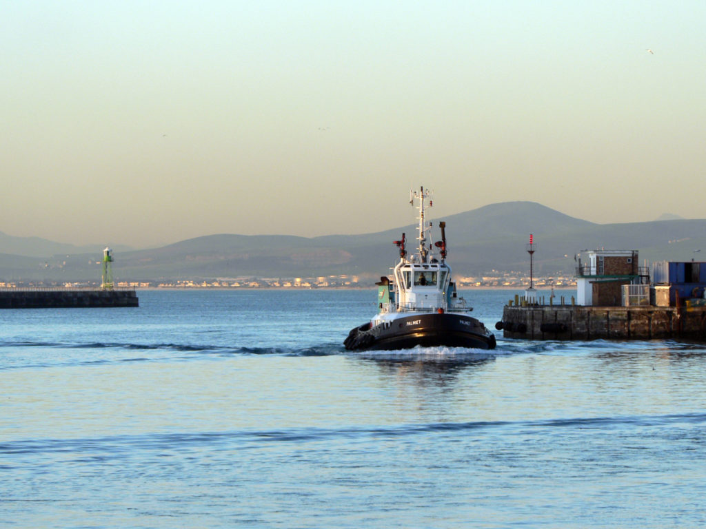 Cape Town, Western Cape province: A tug boat pulling in to the harbour