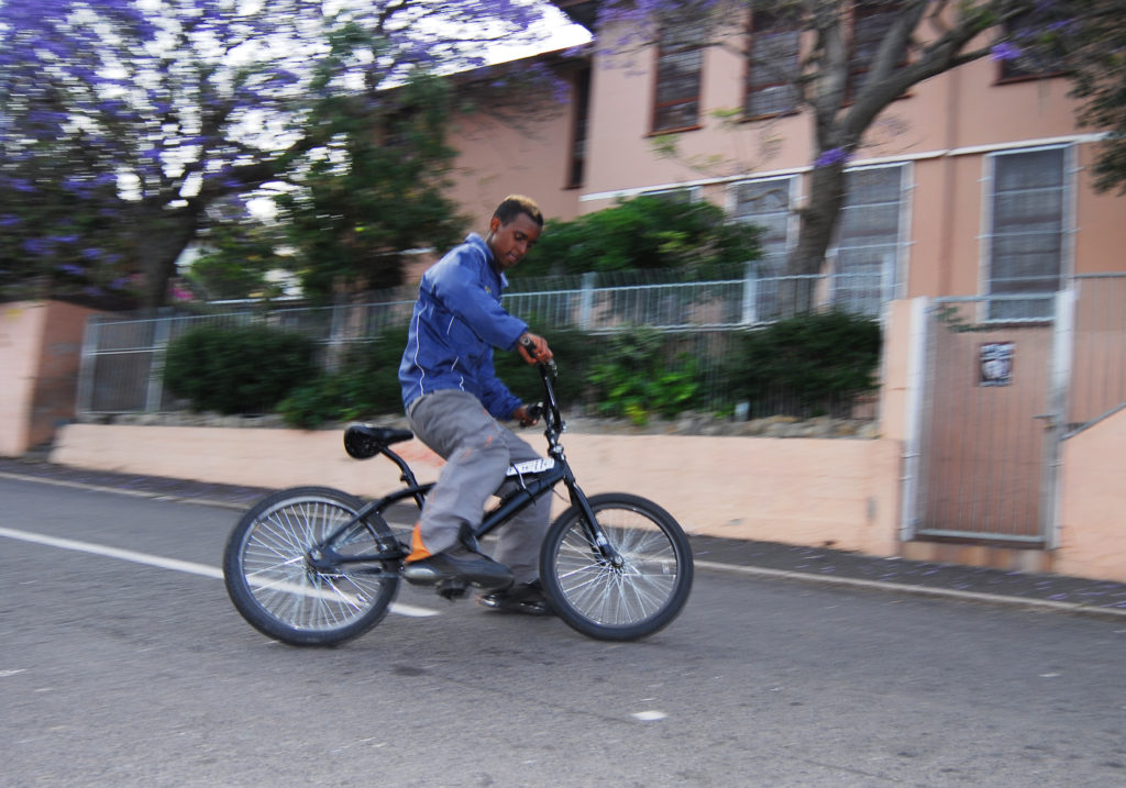 Mohamed Isaacson pulls a power slide on his BMX bike in the suburb of Bo Kaap
