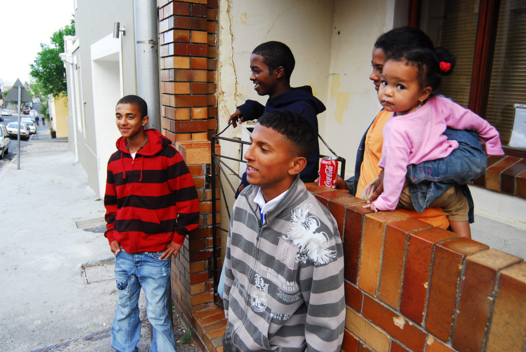 Youngsters hang out outside their home in the suburb of Bo Kaap