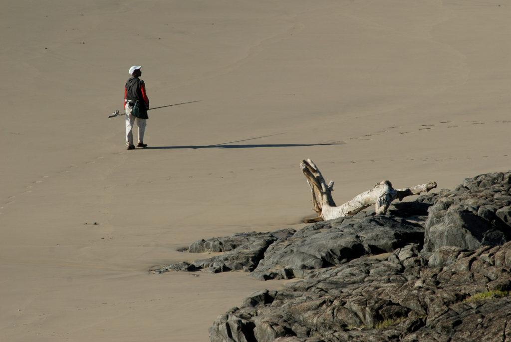 A fisherman walks to the sea near Coffee Bay, on the Wild Coast