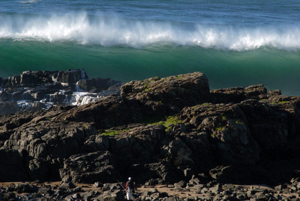 Eastern Cape: A fisherman walks to the sea near Coffee Bay