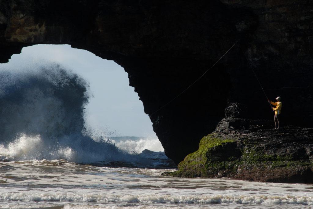 Eastern Cape: Fishermen next to the Hole in the Wall rock formation