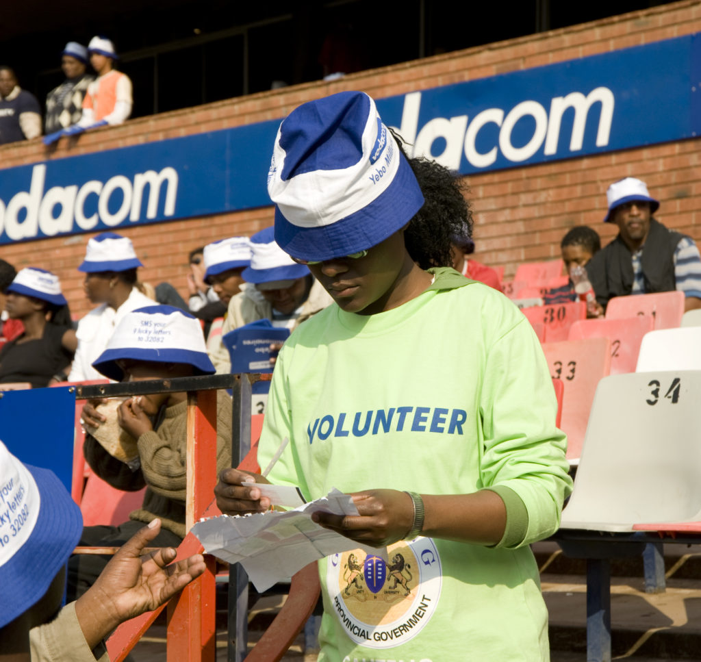 Volunteers help fans find their seats. Soccer Vodacom Challenge final - Manchester United vs. Kaizer Chiefs