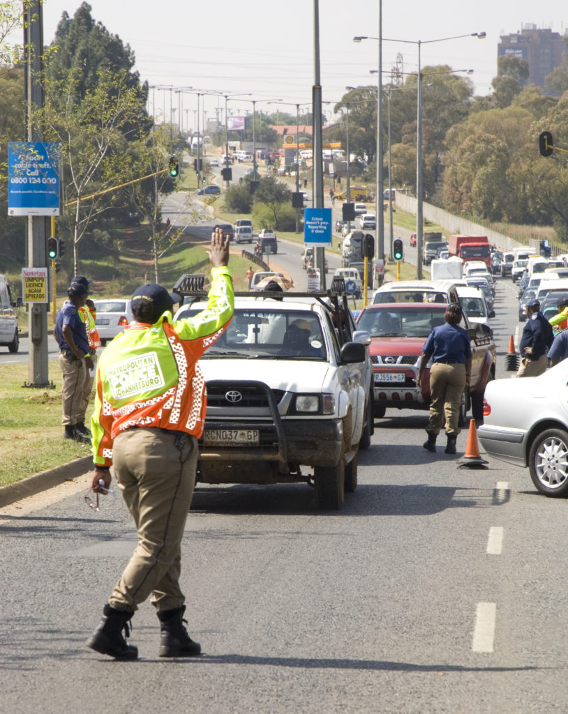 Johannesburg, Gauteng: Metro traffic officers staff at roadblock on Old Potchefstroom Road, Soweto