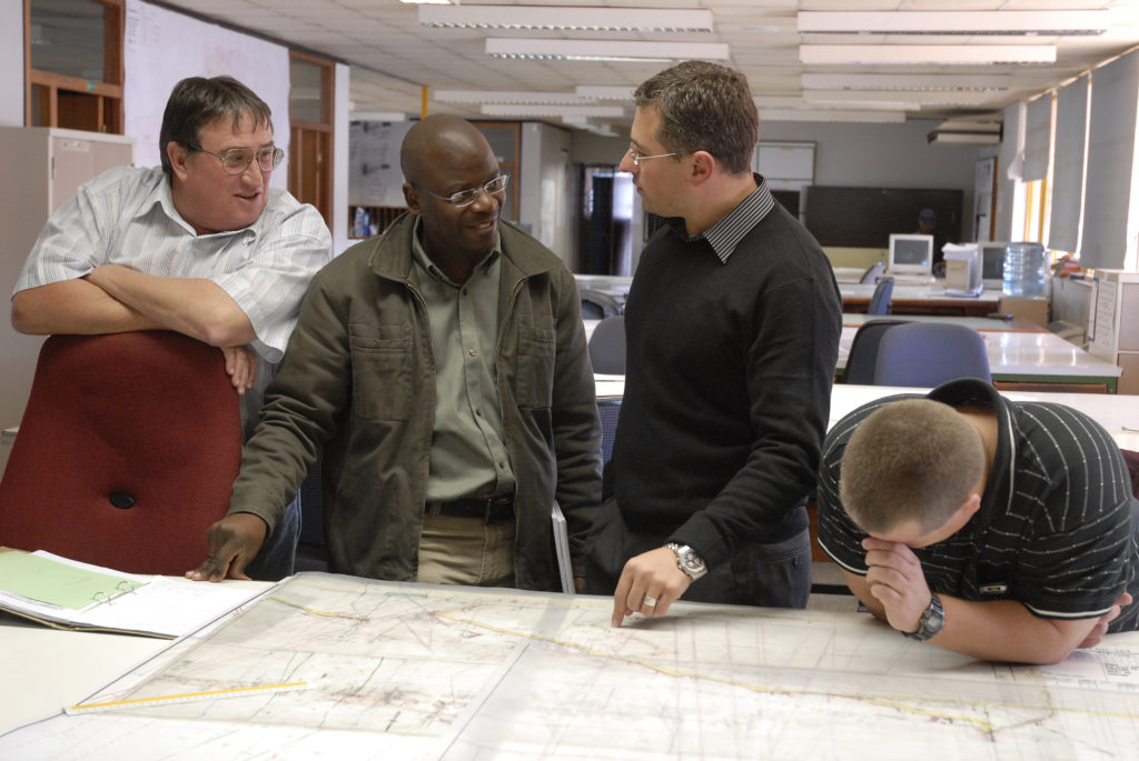 Welkom, Free State: Management and surveyors discuss developments at Harmony Gold Mine