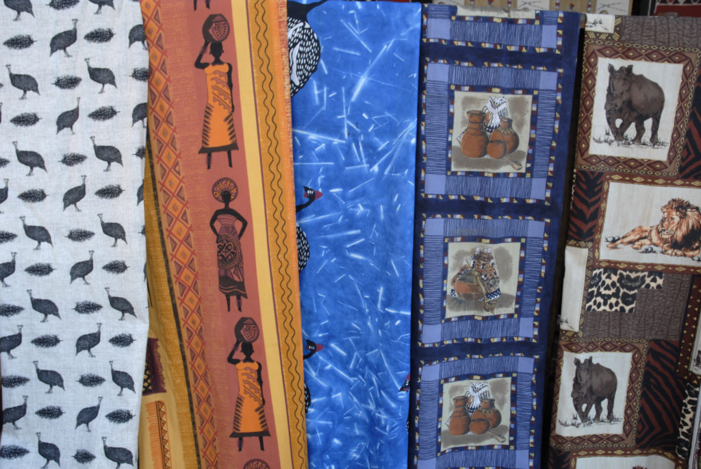 Dullstroom, Mpumalanga: A shop selling curios, African print material and wooden sculptures