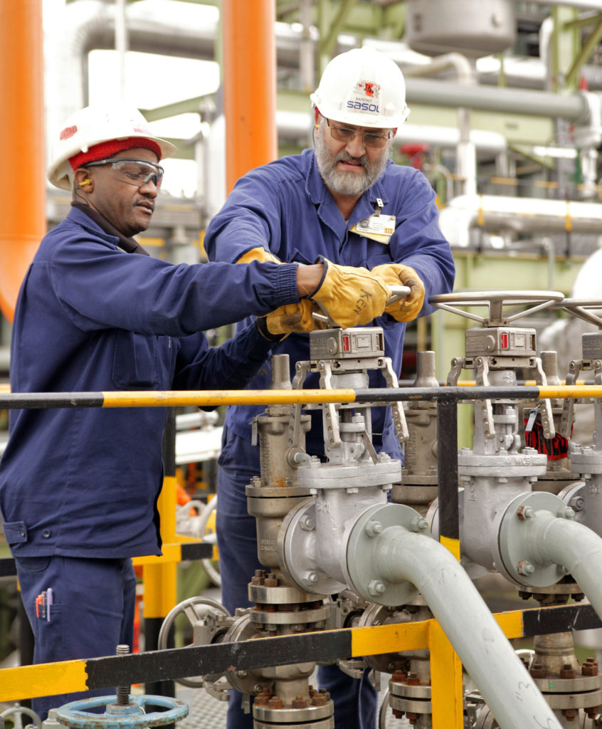 Workers in a Sasol plant