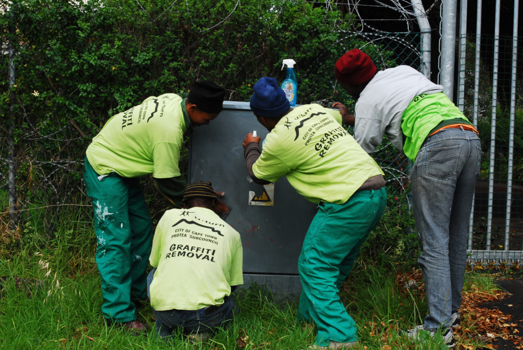 Cape Town, Western Cape province: Workers in Woodstock work to remove graffiti