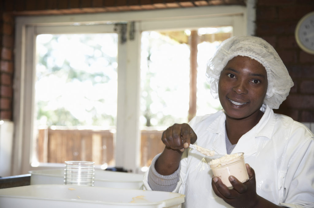 KwaZulu-Natal Midlands: Eunice Madlala at work in the dairy at Swissland Cheese Farm