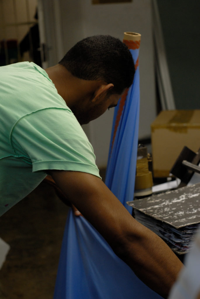 Cape Town, Western Cape: Melvyn Martin, a fabric storeman, inside the design studio of Hip Hop