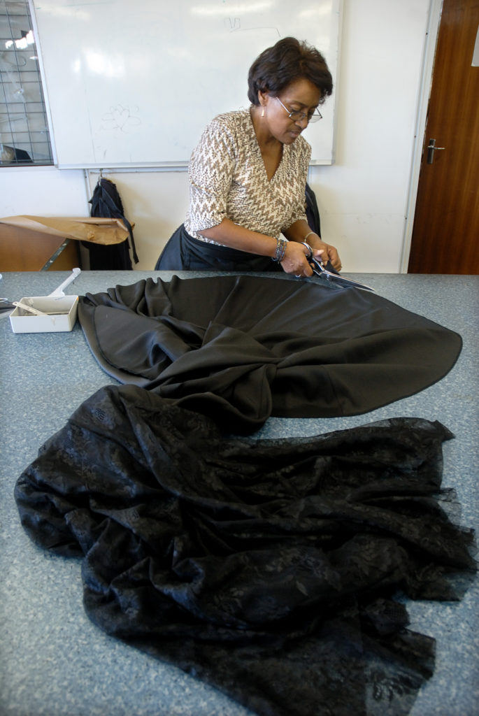 Cape Town, Western Cape: Sylvia Smith trims a dress inside the design studio of Hip Hop