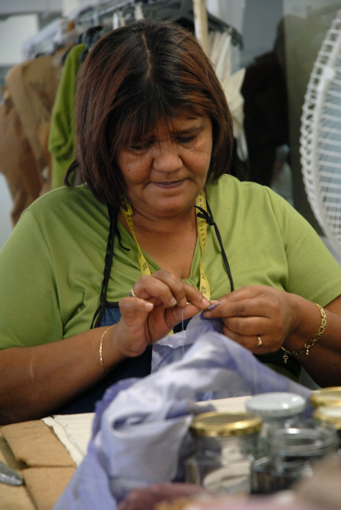 Cape Town, Western Cape: Marilyn Abrahams at work in the design studio and factory of Hip Hop