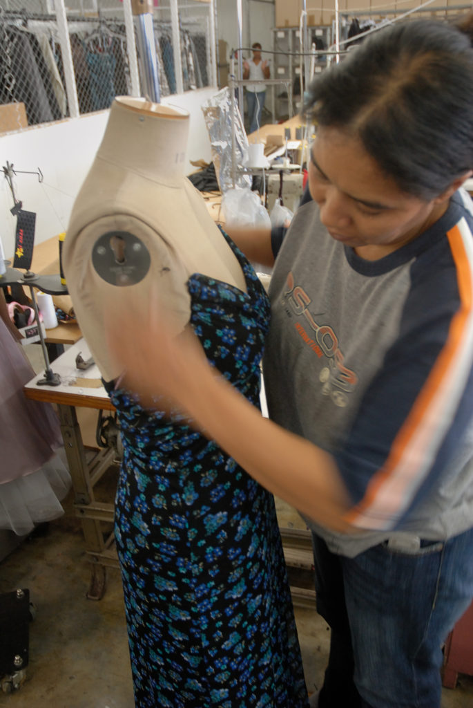 Cape Town, Western Cape: A dress is fitted onto a dummy in the design studio and factory of Hip Hop