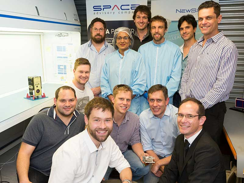 The core team that built SCS Aerospace Group's nSight1 nanosatellite are: (front from left to right): Dr Louis Muller, Dr Francois Malan, Kannas Wiid, Rikus Cronje, Hendrik Burger; (middle) David Brill; and (back row) Heinrich Fuchs, Premie Pillay, Philip Bellsted, Dr Lourens Visagie, Kevin Gema and Marcello Bartolini. (Image: SCS Aerospace Group)