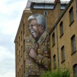 A new street art mural of Nelson Mandela watches over the community of Camden, London