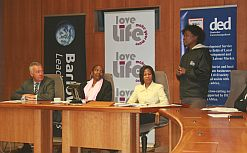 From left: DED's Jürgen Wilhelm, loveLife CEO Grace Matlhape, and Khanyisile Kweyama, Barloworld's group executive for human resources and transformation, listen to a youngster relating his loveLife experience. (Image: Janine Erasmus)