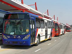 The smart red and blue Rea Vaya buses line up at their specially built stations