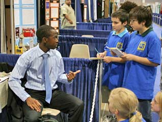 Siyabulela Xuza explains aspects of his project to youngsters who attended the Intel International Science and Engineering Fair in New Mexico, US