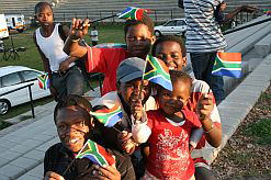 Children blowing plastic vuvuzelas trumpets in Alexandra to mark 200 days remaining until the 2010 Fifa World Cup