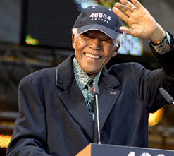 Nelson Mandela waving at the crowd at a  46664 concert, held every year to raise awareness about HIV/Aids