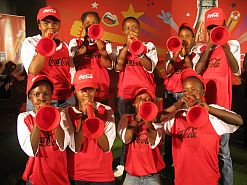 The youngsters from New Nation Primary School will be part of Coca-Cola's flag-bearer and ball crew