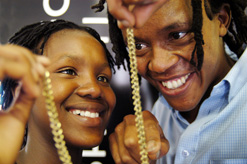 Isaac Nkwe, founder of the Imfundiso Skills Development Project, with one of his jewellery-making students