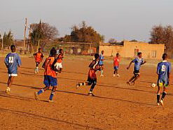 Young footballers training on a dusty field near Mafikeng in the North West province