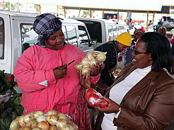 Lungiswa Mama (left), whose stall is at the Mdantsane Highway taxi rank, was one of 90 informal traders who completed the Hawkers Capacity Building and Training Programme.