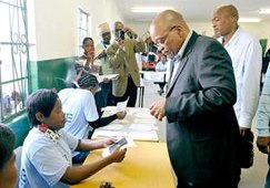 South African President Jacob Zuma prepares to cast his vote in the country's local government elections, 18 May 2011