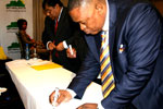 Mpumalanga MEC for Economic Development, Environment and Tourism Norman Mokoena signing the Brand South Africa pledge to uphold the country's core values of ubuntu, diversity, sustainability, possibility and creativity.