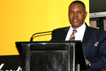 MEC for Economic Development, Environment and Tourism Norman Mokoena speaking at the summit.