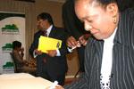 Pinkie Nqeto signing the pledge.