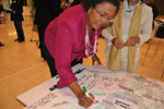 Deputy Chairperson of the IMC Chichi Maponya signing her pledge to play her part in assisting South Africa in gaining global competitiveness