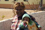 Shirley Merime, co-founder of the Ebenezer Hannah Home holding a baby from the crèche at the home.
