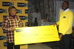 Brand SA CEO, Miller Matola, hands over a cheque of R20 000 to Shirley Merime for the home to buy necessities.