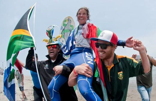 "Simone Robb is carried up the beach by her South African team mates after winning the Women's title in the 2013 ISA World Longboard Surfing Championships at Huanchaco in Peru on Saturday. Photo: <a href=""http://isawlc.com/"" target=""_blank"">ISA / Rommel Gonzales</a>"