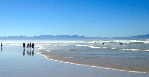Who wouldn't want to be here? Muizenberg Beach in early autumn.