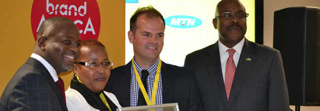 Senior manager of MTN South Africa, Louisa Kodisang (second from left), receives the Top South African Brand award on behalf of her company. She is surrounded by Brand Finance Africa chairman Thebe Ikalafeng, managing director of Brand Finance South Africa Oliver Schmitz and Brand South Africa chief executive Miller Matola.