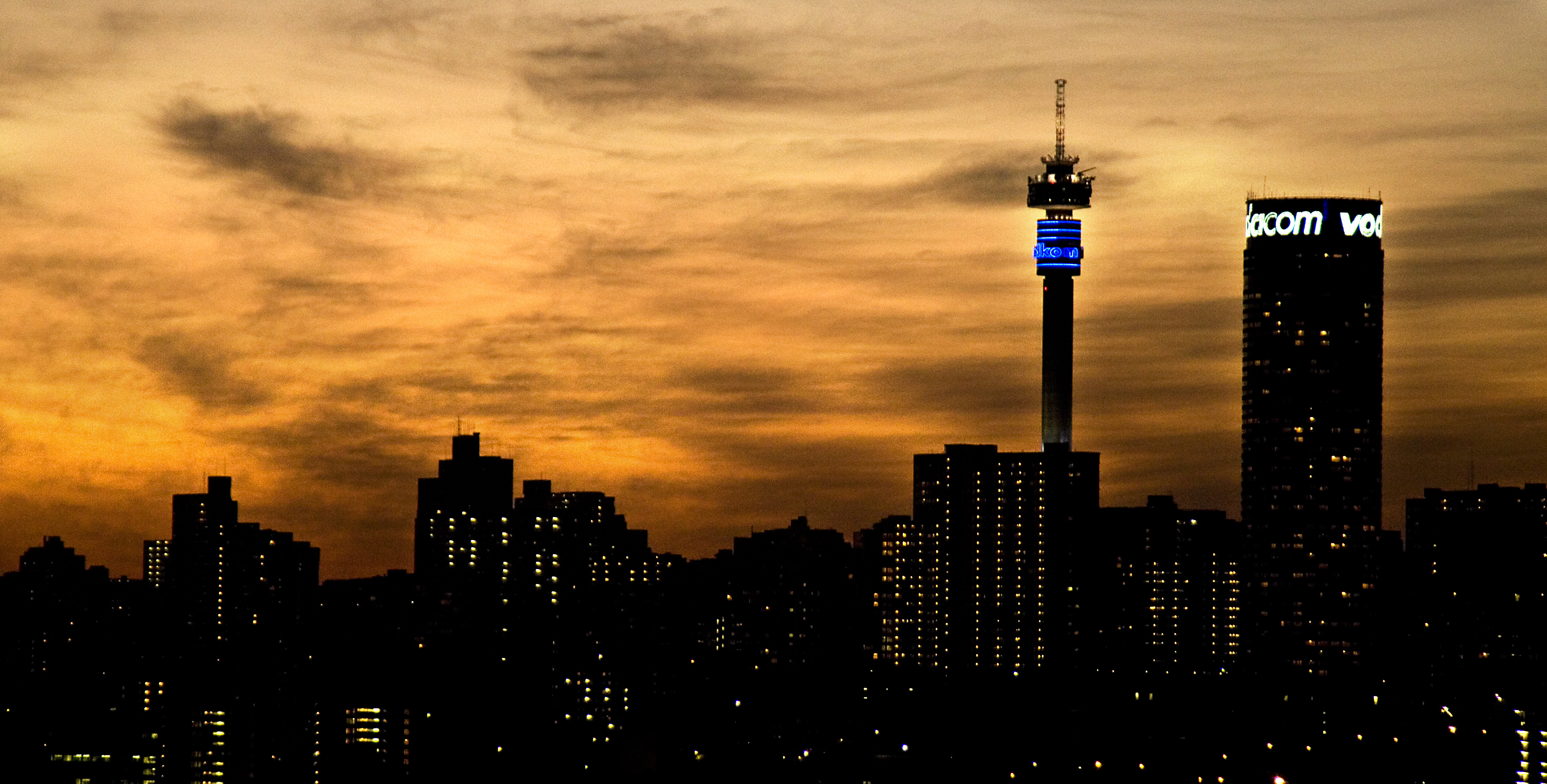 Photo library cities 2 brand south africa johannesburg gauteng province a view of the city centre skyline at sunset from the rooftop of the oribi hotel in troyeville thecheapjerseys Choice Image
