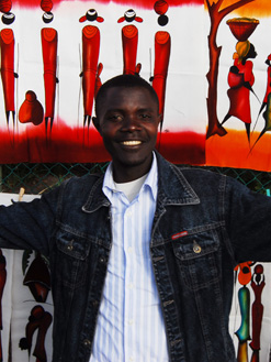 Ugandan artist Samuel Kalule Ssendowooza sells his and others' work in Cape Town, South Africa, helping support his family back home